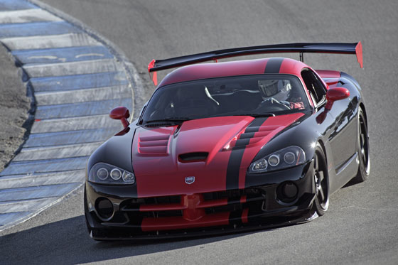 A street-legal 2010 Dodge Viper SRT10 ACR driven by Chris Winkler, SRT vehicle dynamics engineer, set a new lap record of 1:33.915 at the Laguna Seca raceway in Monterey, Calif., shattering the previous lap record by more than 1.1 seconds. (Image: Chrysler group)